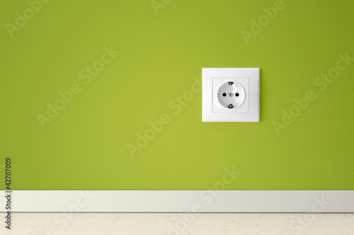 Fototapeta Green wall with european electric outlet obraz