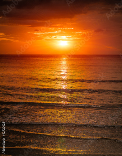 Fotobehang Oranje eclat Sunrise in the sea with softwave and cloudy