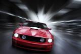 Luxury red sport car speeding in a underground parking