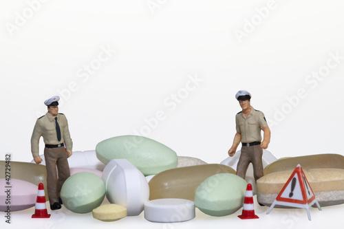 Fotografering  Polizisten mit Tabletten