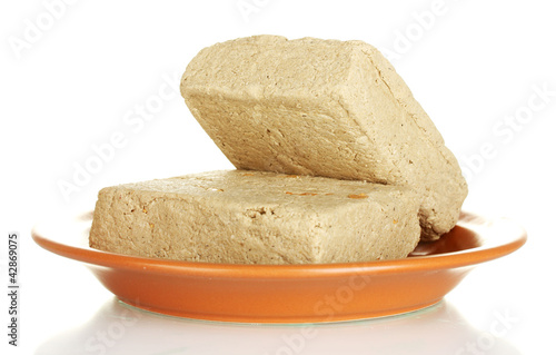 Foto op Aluminium Baobab tasty halva in the plate isolated on white close-up