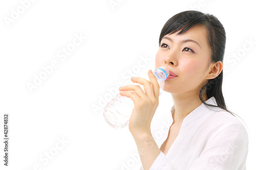Fotografie, Obraz  ミネラルウォーターを飲む女性
