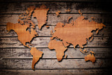 World map carving on wood plank.