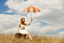 Beautiful Redhead Girl With Umbrella And Suitcase At Outdoor.