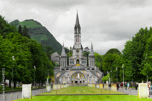 Photo center of pilgrimage to famous cathedral in Lourdes, France.