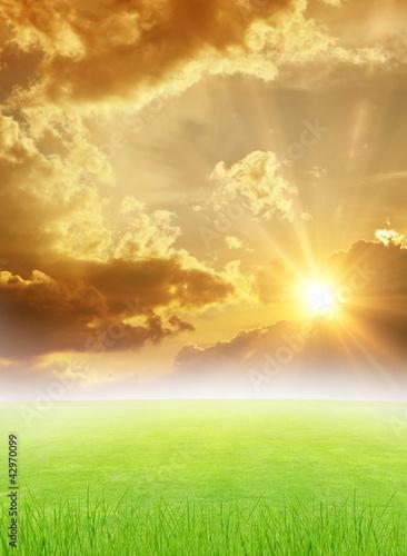 green field and beautiful sunset - 42970099