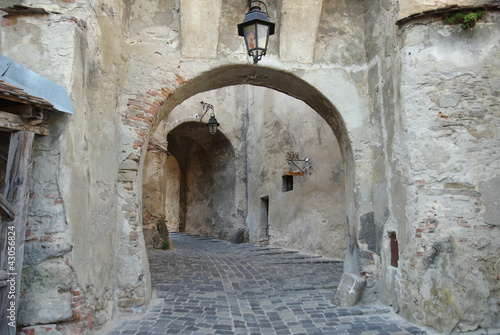 Fotografie, Obraz  Sighisoara, walk under the arches