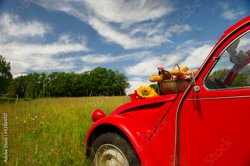 French car with bread and wine Canvas Print