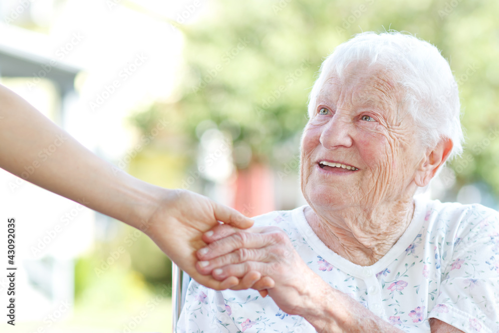 Fototapety, obrazy: Senior woman holding hands with caretaker