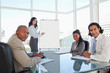 Business team almost smiling in a meeting room during a presenta