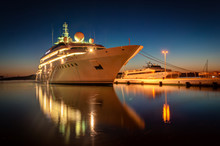 Modern Cruise Liner In The Harbor At Night