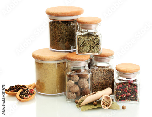 Photo Stands Herbs 2 jars and wooden spoons with spices isolated on white