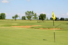 Field With Yellow Golf Flag