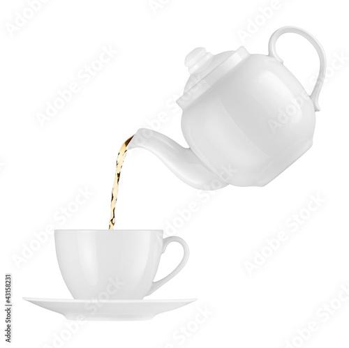 Fotografía Teapot pouring tea into a cup on a white background
