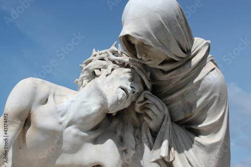 Fotografia  statua cristo e madonna