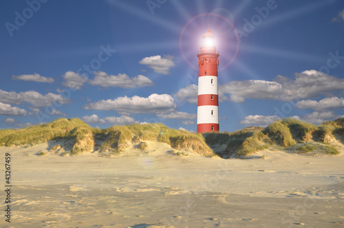 Foto-Leinwand - Leuchtturm in den Duenen