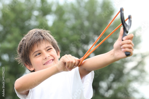 Photo  Boy with slingshot