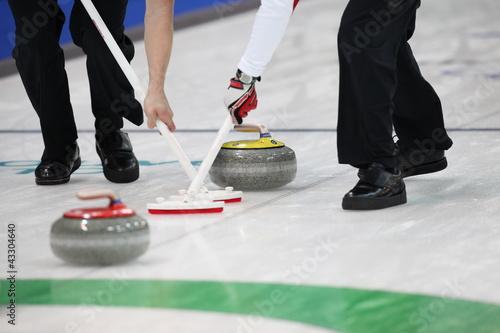Fotografia Curling Wettkampf in der Eishalle.
