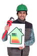 Plumber holding wrench and energy rating sign