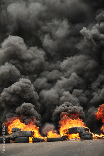 Fotografie, Obraz  Fire during a protest causing poisoning smoke