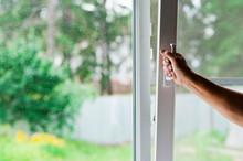 A Man Opens A Window