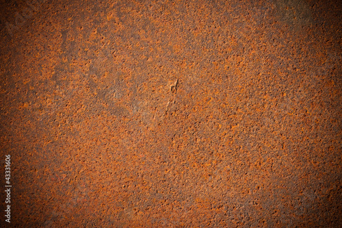 Dark edged rusty metal plate background