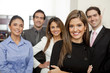 Hispanic business people standing together in office