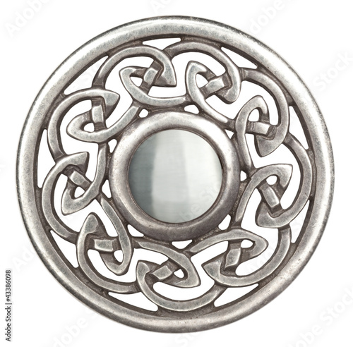 Silver celtic brooch in isolated on white  Super macro Fototapeta