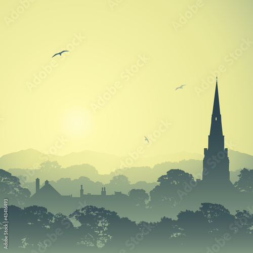 Fototapeta A Country Landscape with Church Spire and Trees obraz