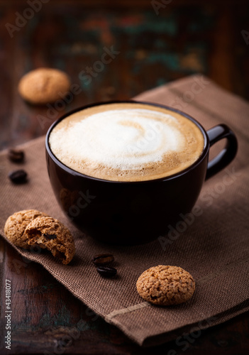Fotografie, Obraz  Cup of cafe au lait and biscotti on the table