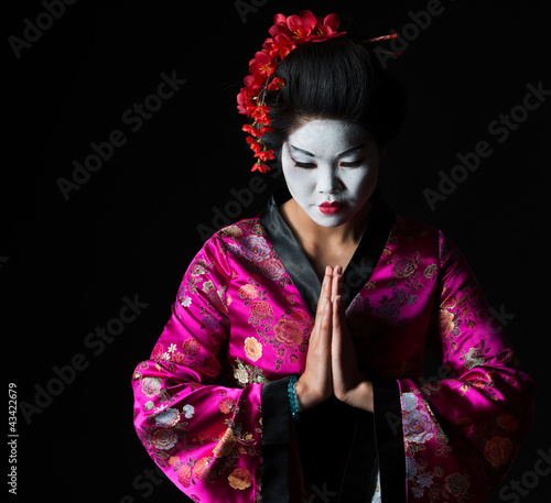 Fotografía Portrait of geisha with hands together respect gesture isolated