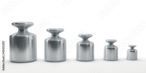 Fotografia  Row of calibration weights isolated on white.
