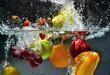 Leinwandbild Motiv Fruit and vegetables splash into water