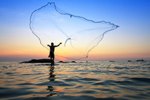 Throwing Fishing Net During Sunrise, Thailand