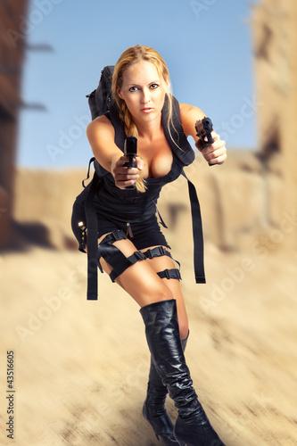 фотография  woman holding two hand gun