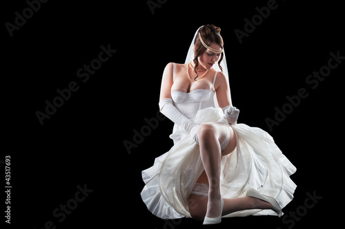 Valokuva  Lovely sensual bride in modern lingerie on black background