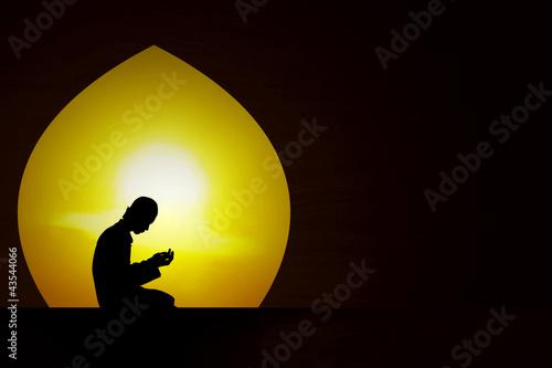 Photo Praying at sunset