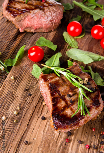 Papiers peints Steakhouse Delicious beef steaks on wooden planks
