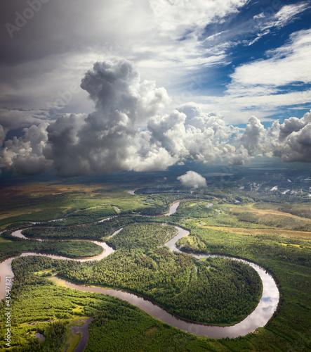 Fototapeta Forest river under the white clouds obraz