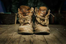 Pair Of Old Boots On Wooden Fl...