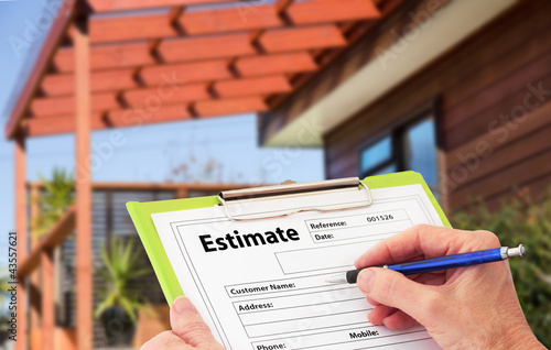 Fotomural Hand Writing an Estimate for Home Building Renovation