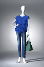 Full Length Mannequin Dressed In Shirt And Blue Jeans