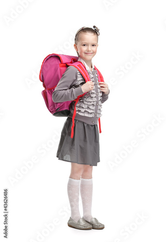 Photo  Self-disciplined pupil is ready to go to school, isolated