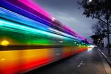 Fototapeta Tęcza - Rainbow traffic blur in night city