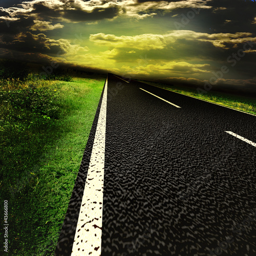 Photo  Asphalt road and red bloody blurred sky with sun