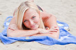 Photo of a young and beautiful woman resting on the sea coast