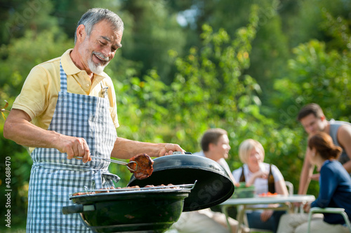 Fotografie, Obraz  Family having a barbecue party