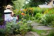 canvas print picture - Seniorin im sommerlichen Garten