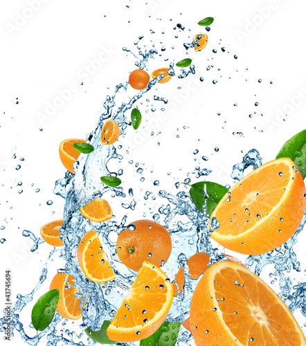 Poster Splashing water Fresh oranges in water splash on white background.