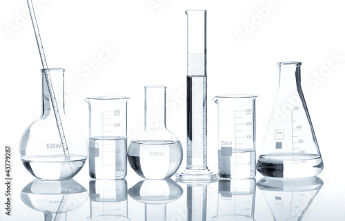 Fotografia  Group of laboratory flasks with a clear liquid, isolated